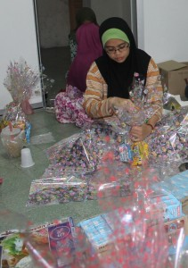Students from PMC Community Outreach Society packing goodies for Temiar people