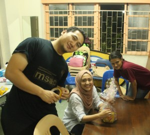 Members of the PMC Community Outreach Society tirelessly packing goodie packs for the Temiar people the night before the trip.